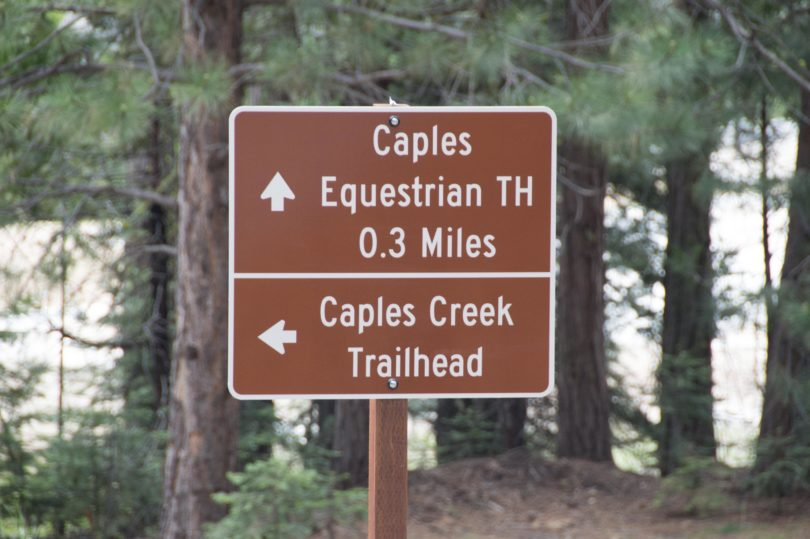 Caples Creek trailhead sign before Fitch Rantz Bridge